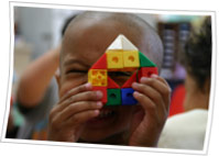 Young child playing with toy blocks..